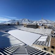 Snowy Folsom Field with Flatirons in the background