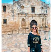 CU Boulder fan wearing a Buffs shirt in front of the Alamo