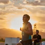 Jake Riley runs as the sun sets.