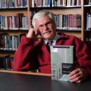 michael radelet posing with his book