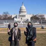 Students Zahra Abdulameer and Shay Mannik pose in front of the Capital building.