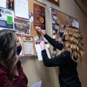Sabrina Arredondo Mattson (left), senior research associate for the Center for the Study and Prevention of Violence, watches gun retailer Jacquelyn Clark post materials from the Gun Shop Project.