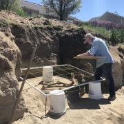 Paleontologist Rick Hunter excavates the skeleton.