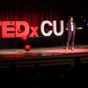 Nina Williams rehearses her presentation on the TEDxCU stage.