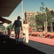Couple walking new pedestrian walkway on Pearl Street