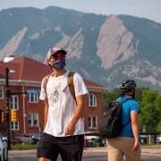student in mask at CU Boulder
