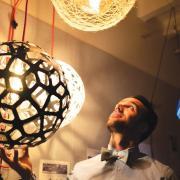 Nicholas Defaria looks at his lamps