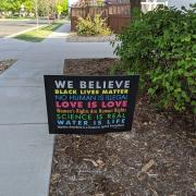 We Believe Law Sign