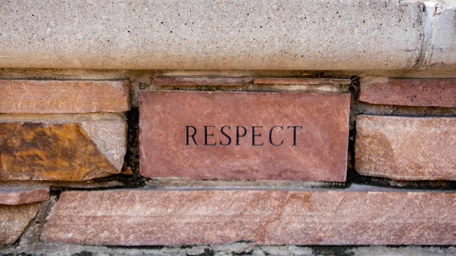 Respect written on a brick
