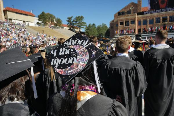 "Graduate cap reads ""Shoot 4 the moon"""