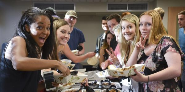 Students at community dinner