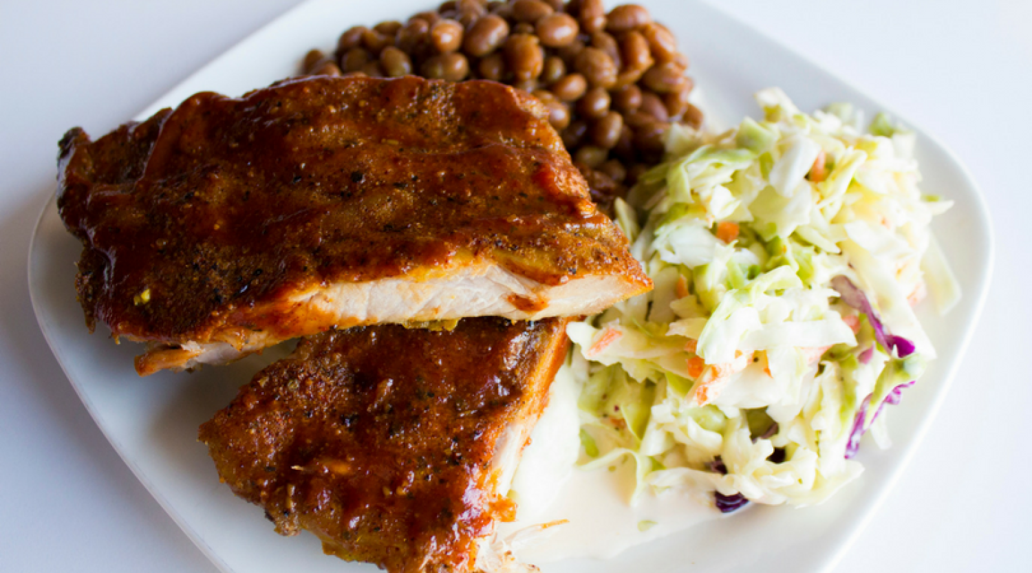 Grilled pork ribs, coleslaw, baked beans