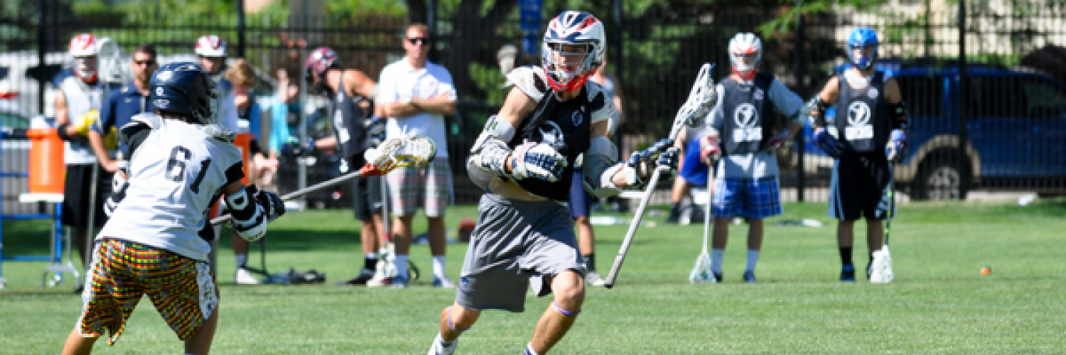 Two camp attendees playing lacrosse