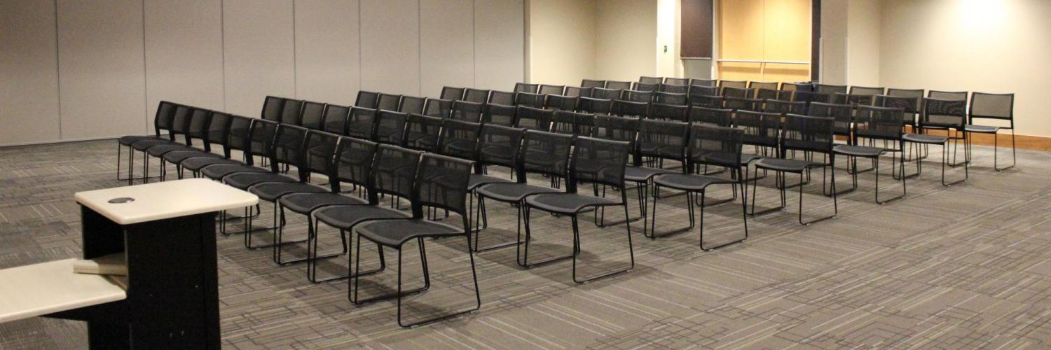 Kittredge Multipurpose room set up for a speaker with rows of chairs facing the podium
