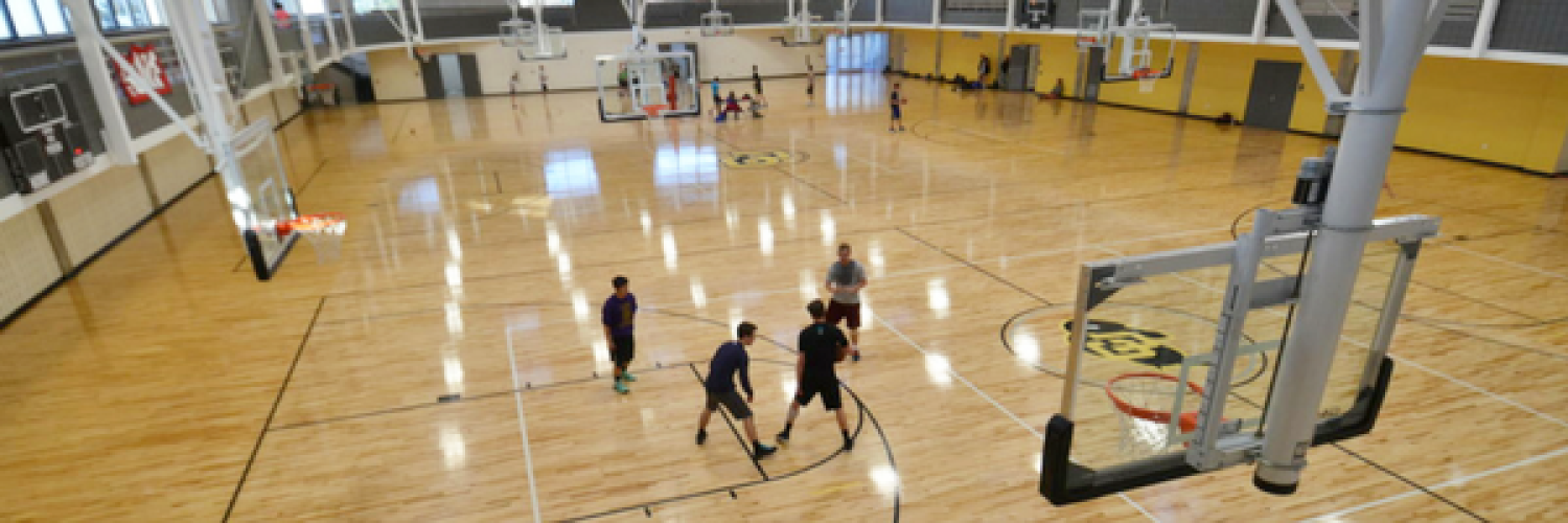 Rec Center basketball court with people playing a game