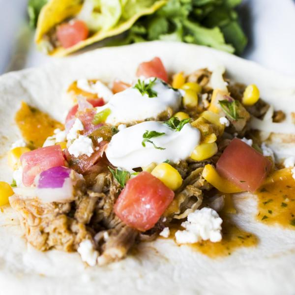Soft taco with shredded pork, cheese, pico de gallo, crema and cilantro
