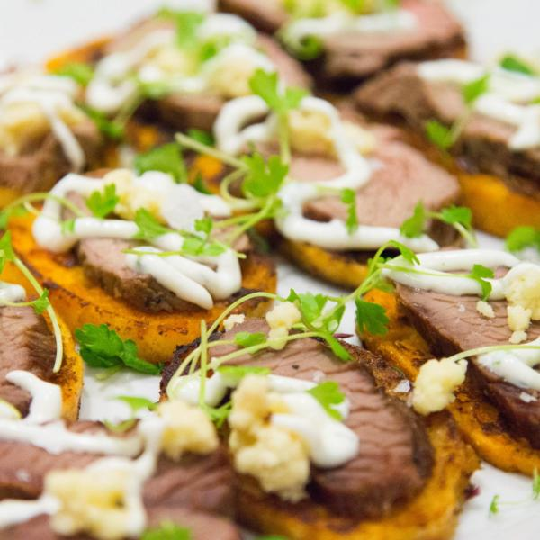 Crostini with thinly sliced beef, horseradish sauce and watercress