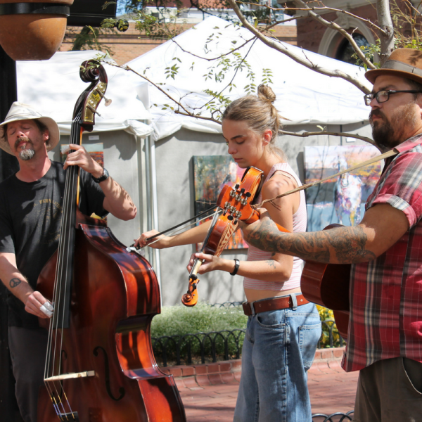 Three musicians playing on Pearl St. Mall