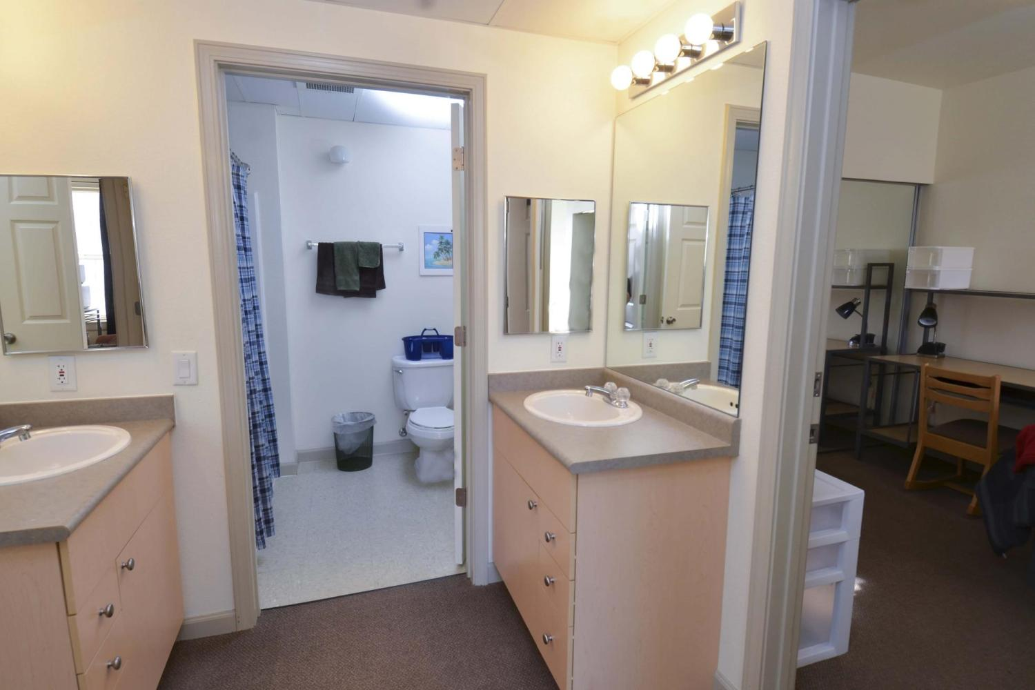 Bathroom area with two vanities and one shower area