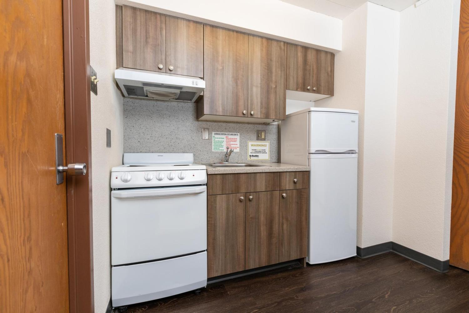 Remodeled kitchen with oven, sink, refrigerator, and freezer (Stearns West)