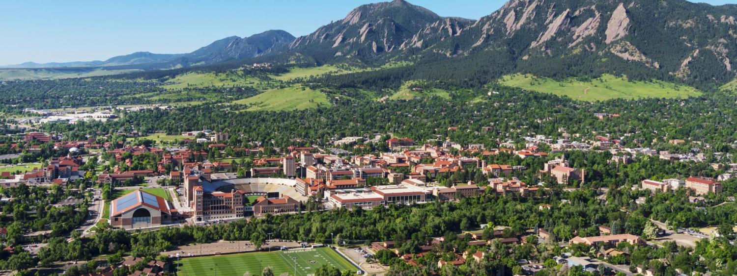 Aerial photo of the Boulder area including campus and the Flatirons Mountains