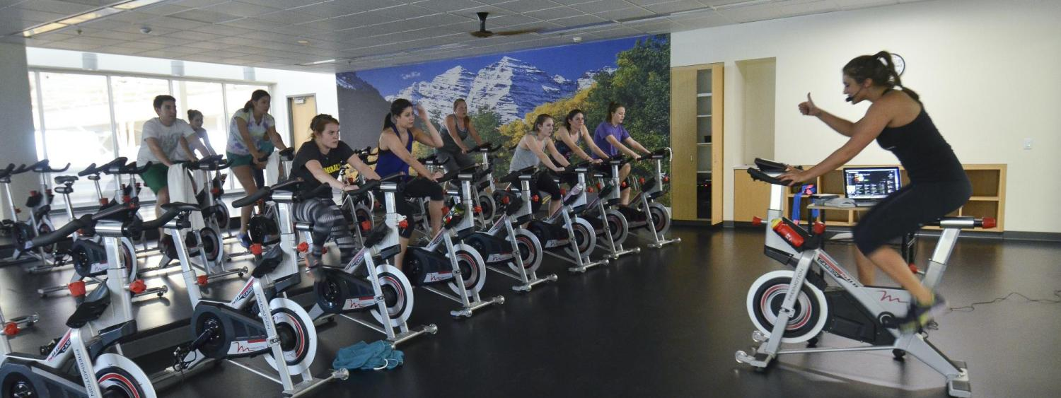 A group of people on stationary bikes