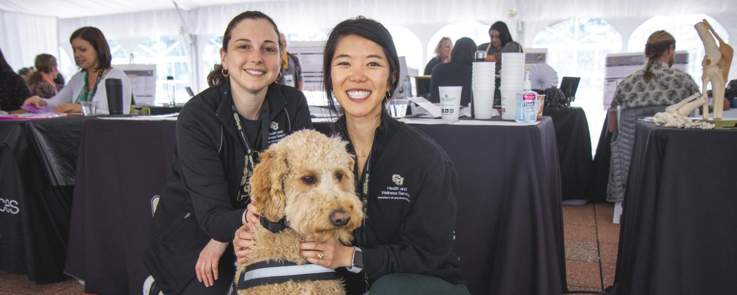 Students posing with CAPS therapy dog