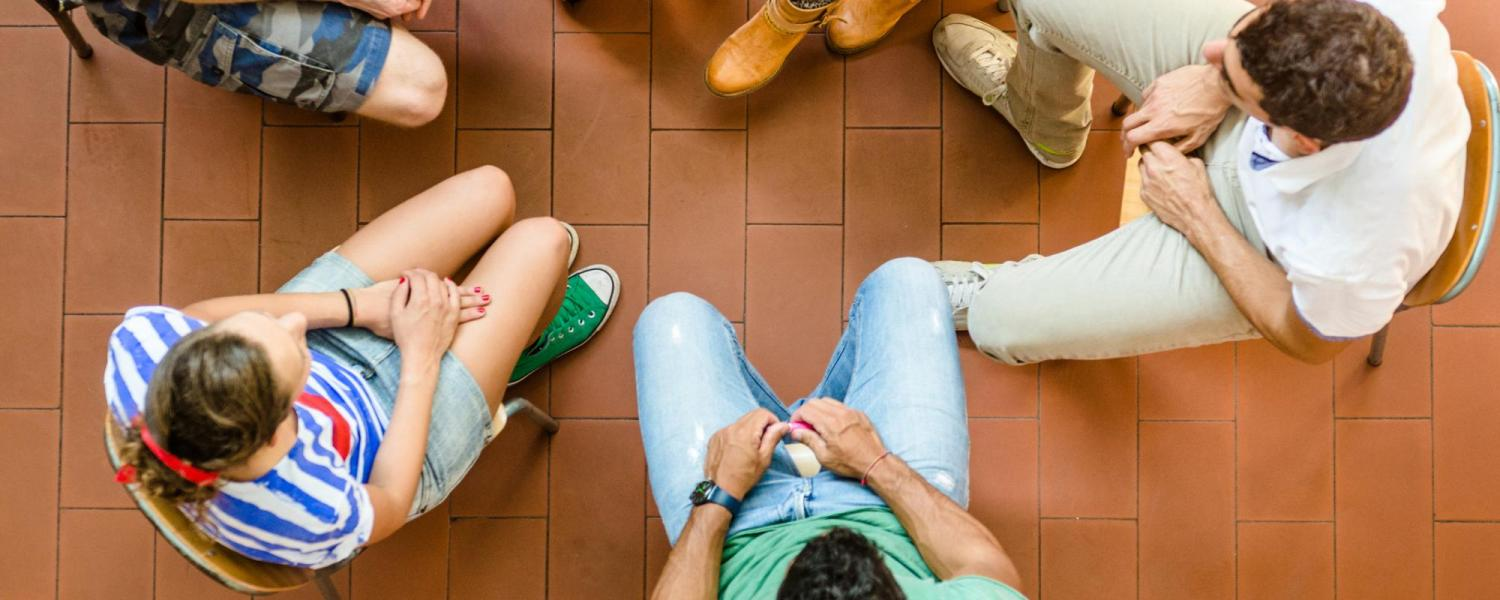 Students sitting in a group circle