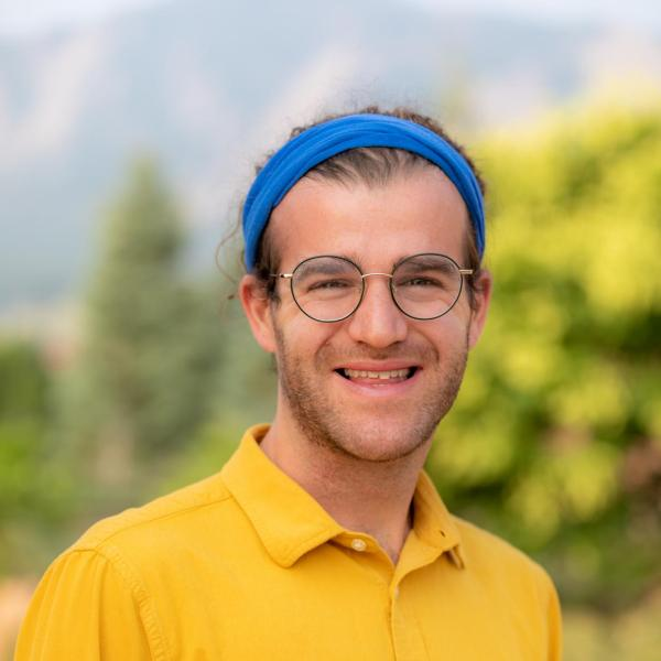 young man in a headband smiling