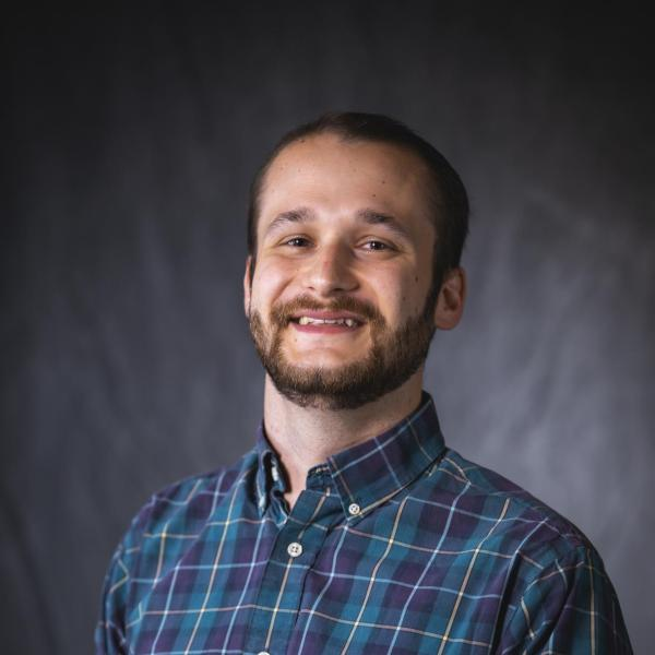 man in flannel shirt smiling