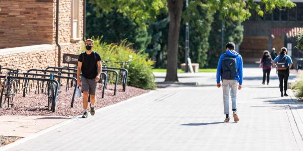 two students walking in opposite directions