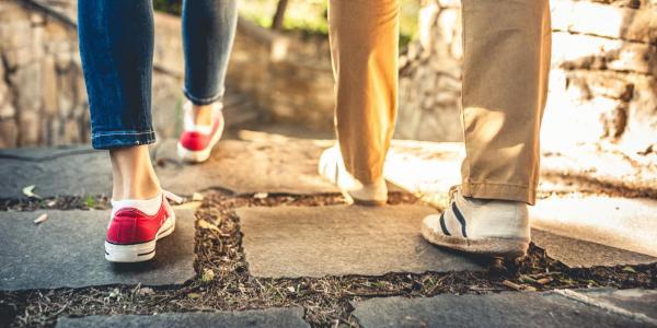 Two people walking down path