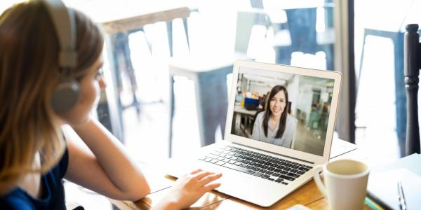 Two people chatting over video conference