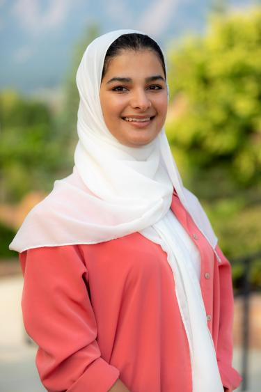 woman in a bright hijab smiling