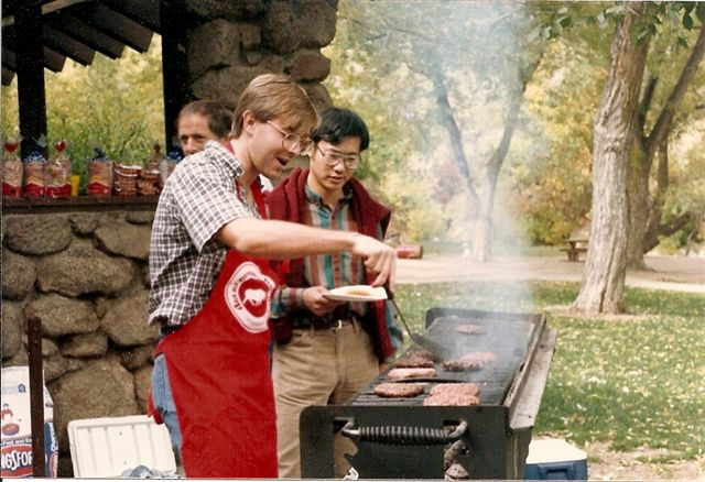Adam and Xiaodong Zhang at a cookout during their grad school days.