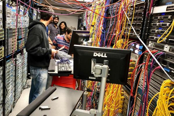 Network Engineering students working in the network engineering lab with network cabling