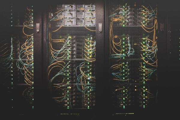Lockers containing stacked servers and cables