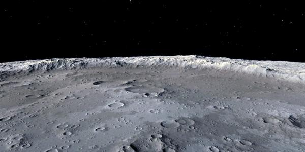 The surface of the moon, with empty space in the background
