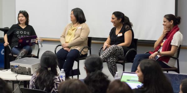 Rupa Dachere, left, leads a panel at DevPulseCon 2015
