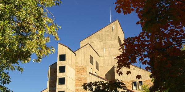 The Engineering Center tower with fall leaves in the foreground.