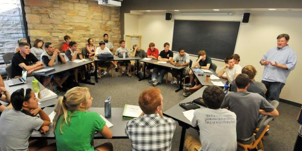 Scot Douglass leads a group discussion for Engineering Honors students.