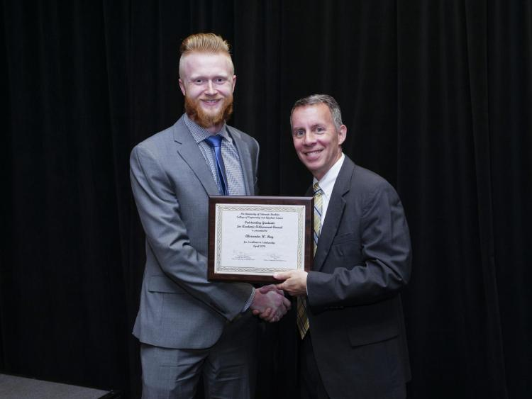 Ray with Dean Bobby Braun at the Engineering Awards banquet.