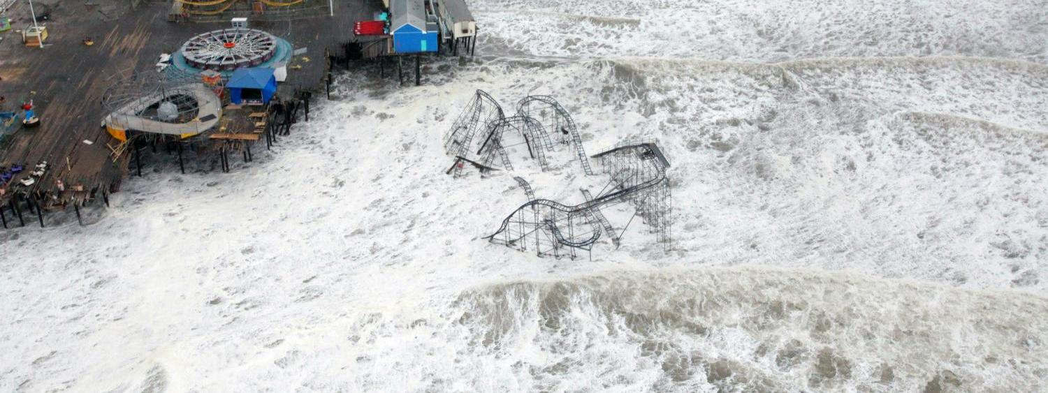 An aerial photo of Hurricane Sandy washing away a pier in New Jersey