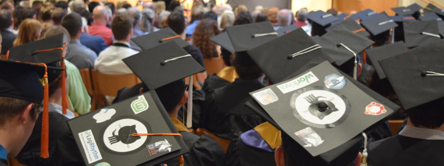 Decorated mortarboards at the 2016 Computer Science graduation ceremony.