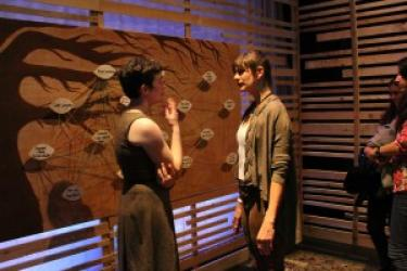 A cast member interacts with an audience member during a Quantified Self performance