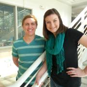 Topplers winners Austin Holler and Julia Heil on the staircase in the DLC.