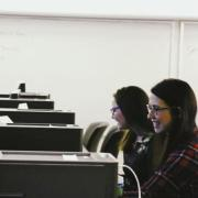Photo by the Daily Camera shows two women participating in the hackathon.