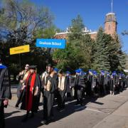 Faculty members and PhD graduates on their way to commencement.