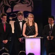 Tommy Hoffmann and his teammates accept their award onstage at the BAFTA ceremony.