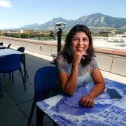 Bhavna on the balcony of the Google Boulder offices overlooking the Flatirons